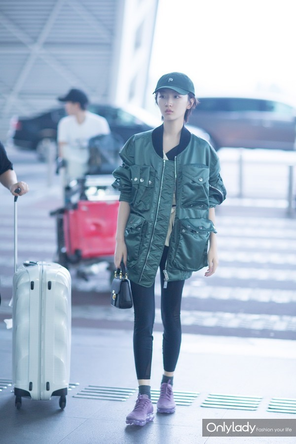 Zhou Dongyu wearing a Burberry Contrast Collar Lightweight Flying Jacket and carrying a mini DK88 bag at Chengdu airport June 24th ,2017
