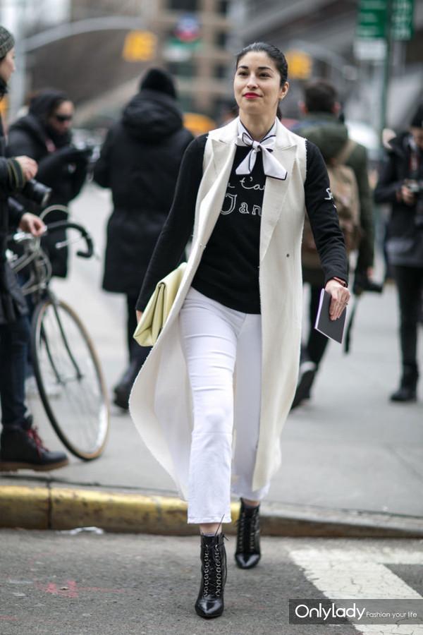sleeveless-jacket-long-vest-white-jeans-lace-up-booties-graphic-sweatshirt-scarf-around-neck-caroline-issa-work-weekend-nyfw-street-style-ps-640x960
