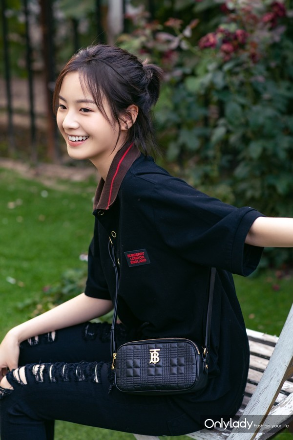Teresa Li carrying the Burberry Lola bag 1